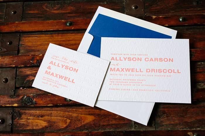 Ellipse is an ultra-modern wedding invitation design with blind debossed patterns on the front of the invitation cards, bold fonts and vibrant ink colors that pop against a bright blue envelope liner.