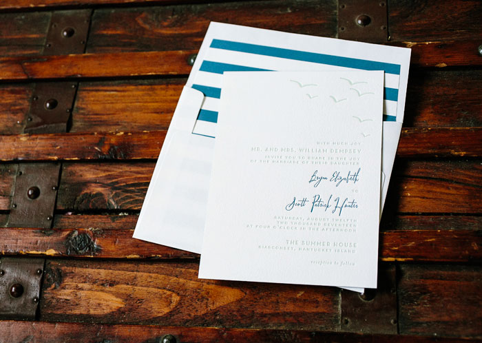 Breezy fonts and beachy motifs make Waterfront perfect for a seaside wedding. Switch out colors, fonts, motifs, and envelope  liner patterns to make this your own!